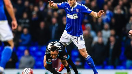 Piort Malarczyk and Kyle Bennett battle during the Ipswich Town V Portsmouth (Emirates FA Cup Third