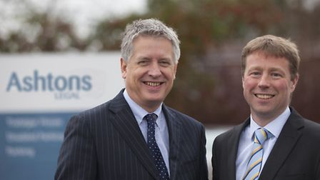 Mark Merriam, chairman of Ashton KCJ, left, and Edward O�Rourke, chief executive, with a sign carryi