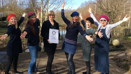The Blossom Charity team with their Guinness World Record for the World's Longest Fashion Show. Pict