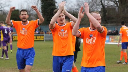 Players ( L to R) Mark Philips, Matt Fry & skipper Kenny Davis celebrate with the crowd at the end.