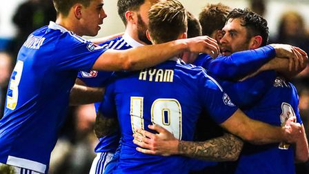 Daryl Murphy (right) is congratulated by his team mates after putting Town into a 1-0 lead from the