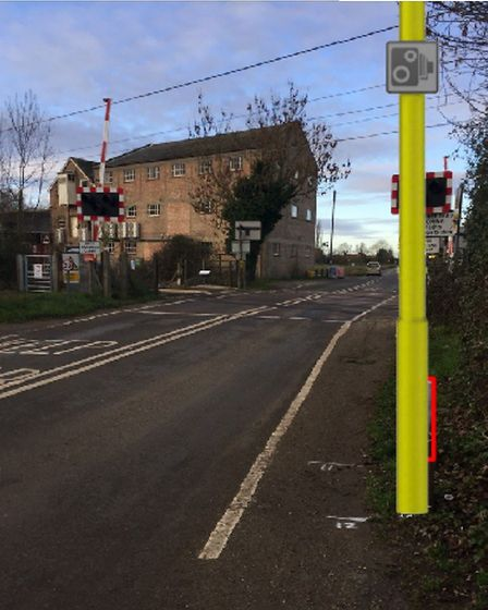 Impression of the column for cameras planned to monitor the railway level crossing at Mellis. Pictur