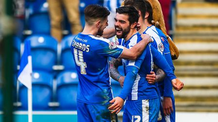 Elliot Lee (number 12) celebrates with Joe Edwards after scoring early in the second half, to level