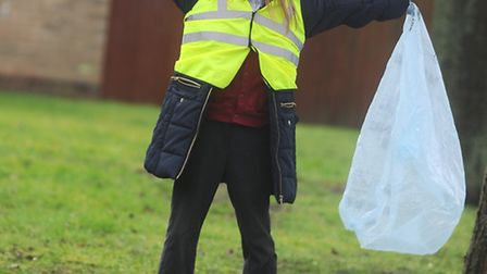 Clean for the Queen. Volunteers in Bury St Edmunds cleaning up at the Southgate Community Gardens. P
