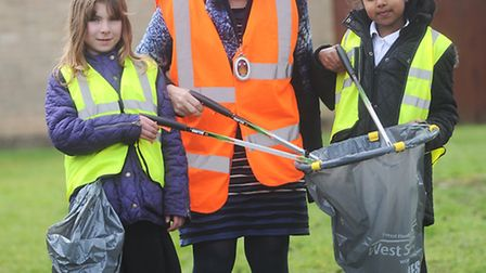 Clean for the Queen. Volunteers in Bury St Edmunds cleaning up at the Southgate Community Gardens. L