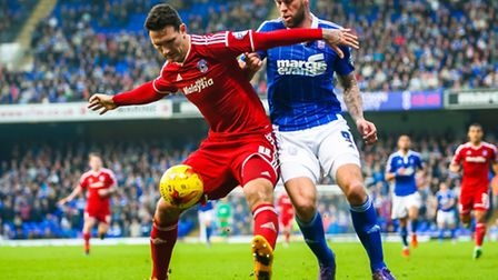 Daryl Murphy battles with Sean Morrison during the Ipswich Town v Cardiff City (Championship) match