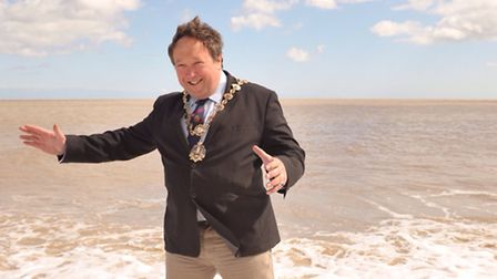 Former Southwold mayor Simon Tobin, pictured celebrating a bathing water award for the town