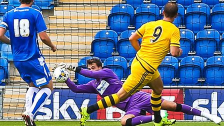 Sam Walker makes a good save, in pre-season, before he got injured. He has not played a league game