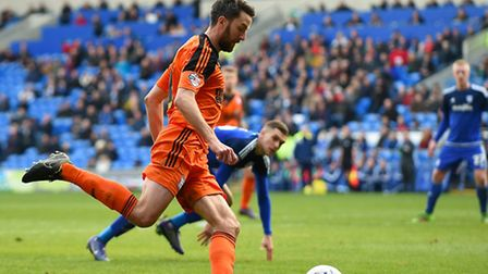 Cole Skuse delivers a second half cross at Cardiff