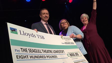 Persimmon Homes Anglia managing director Andrew Fuller presents a Community Champions cheque to Caro