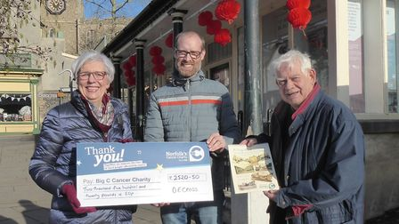 Big C head of fundraising Carole Slaughter receives a cheque for money raised from nostalgic calenda
