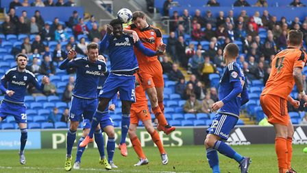 Tommy Smith leaps with Bruno Ecuelle Manga during the first half at Cardiff