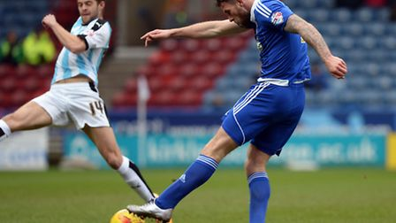 Daryl Murphy fires a second half shot just wide at Huddersfield on Saturday