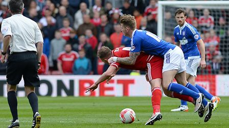 Luke Hyam was booked for this rugby tackle on Jordan Rhodes at Middlesbrough