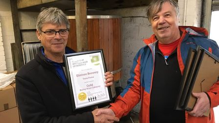 Brewer at Elmtree Brewery in Snetterton Allan Cooper, right, being award for his winning beer Terra