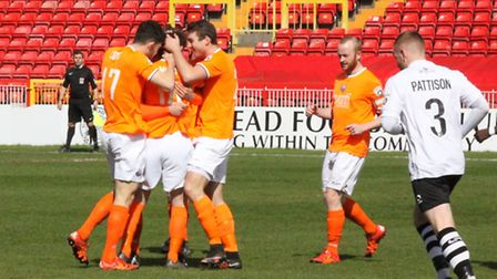 Taylor Miles puts Iron ahead at Gateshead and is swamped by team-mates