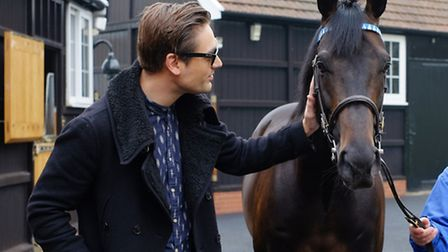 Busted's Charlie Simpson, from Woodbridge, meets Golden Horn at the Dalham Hall Stud. Photo: The Jo