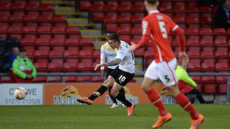 George Moncur forces a save from the Crewe keeper Ben Garratt during the first half