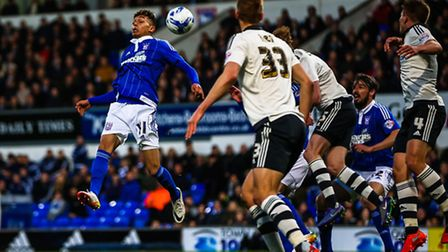 Andre Dozzell tries to send this ball towards goal in the first half of the Ipswich Town v Fulham (C
