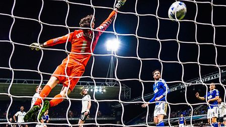 Jonas Knudsen celebrates after his effort beats Fulham keeper Marcus Bettinelli to level the score a