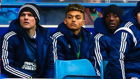 On the bench: Andre Dozzell (centre) watches the action during the Ipswich Town v Nottingham Forest