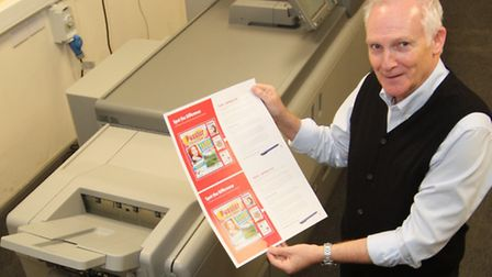 Mike Noye, sales account manager at Ipswich print firm Greenshoots, with the new Heidelberg Linoprin