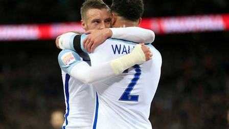 England's Jamie Vardy (left) celebrates scoring his side's first goal of the game with teammate Kyle
