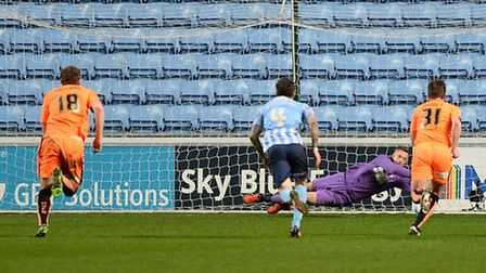 Elliott Parrish saves a penalty late in the first half at Coventry