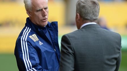 Mick McCarthy shakes hands with Wolves manager Kenny Jacket before the game.