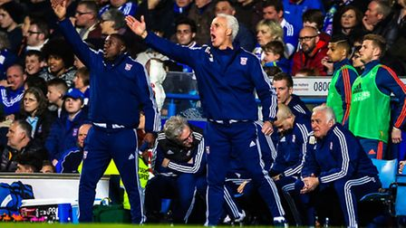 Town manager Mick McCarthy and his assistant Terry Connor give synchronised instructions late on in