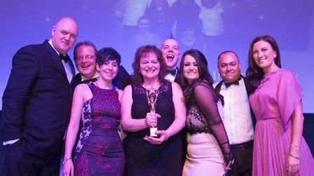 The team from AXA in Ipswich receive the Customer Service Team of the Year trophy at thel British Ex