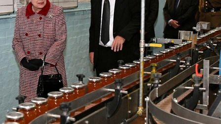 Queen Elizabeth II during a tour of the Wilkin and Son's jam factory in Tiptree
