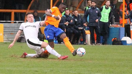 Sim Akinola gets past his marker watched by the Braintree bench