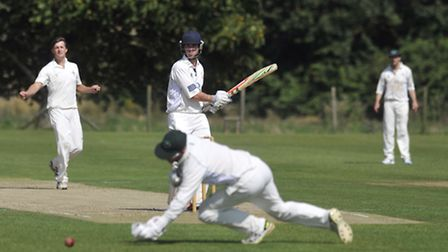 Frinton's Kyran Young bats against Woolpit Cricket Club.