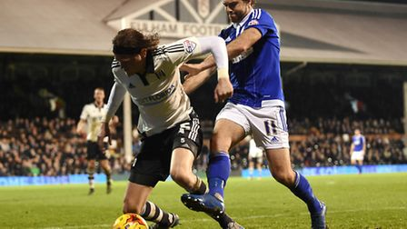 Brett Pitman shoves Richard Stearman in the back trying to get to the ball at Fulham