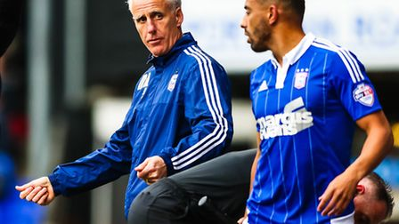 Town manager Mick McCarthy gives Liam Feeney instruction ahead of the Town player coming on during t