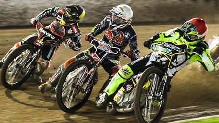 Danny King inside Ulrich Ostergaard and Nicklas Porsing during heat thirteen of the Ipswich v Peterb