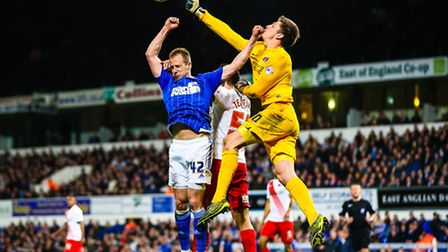 Luke Varney in a battle with Charlton keeper Nick Pope and Jorge Teixeira during the Ipswich Town v
