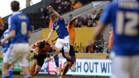 Luke Varney with a glancing header wide of the target at Wolves