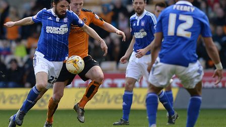 Jonathan Douglas goes past a challenge at Wolves