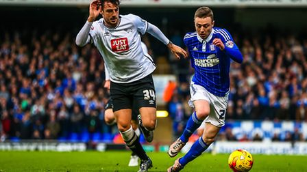 Freddie Sears on the ball and fending off the challenge of George Thorne during the Ipswich Town v D