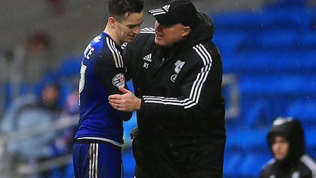 Cardiff's Tom Lawrence gets substituted and is greeted by manager Russell Slade during the Sky Bet C