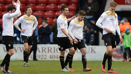 U's players make their way off the pitch at Walsall after last weekend's soul-destroying 2-1 defeat.
