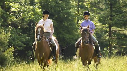 File picture of two horse riders.