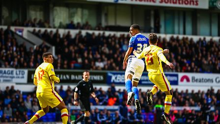 Myles Kenlock heads towards goal during the first half of the Ipswich Town v Milton Keynes Dons (Cha