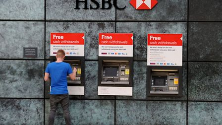 File photo dated 15/09/14 of HSBC cash machines, as the bank posted a sharp drop in profits for the