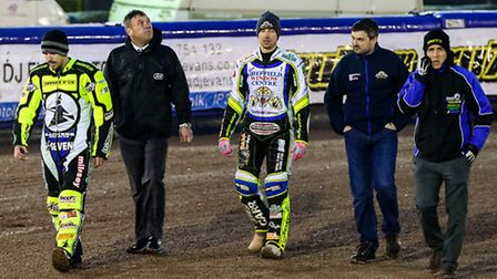 Speedway Control Board referee Stuart Wilson looks up to the heavens on a track walk with team manag