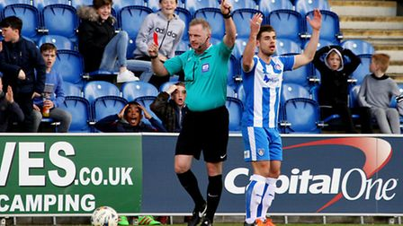 Colchester fans share Joe Edwards' amazement at the red card shown by referee Mark Heywood