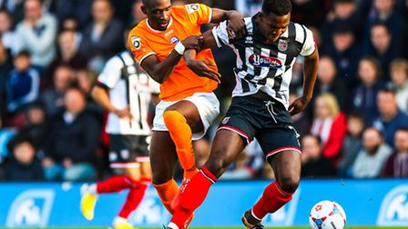 Simeon Akinola battles with Evan Horwood during the Grimsby v Braintree (National League Play-off se