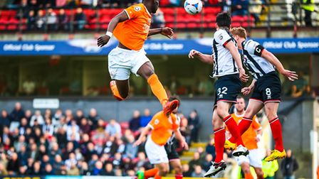 Simeon Akinola jumps high but just fails to connect with the ball during the first half of the Grimb